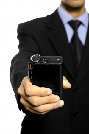 Businessman speaking into a dictaphone recorder isolated over white background