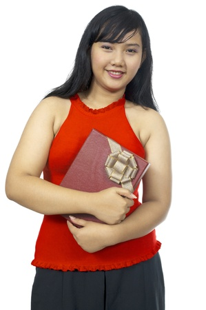 ugly girl: Fat asian chubby girl holding present isolated over white background Stock Photo