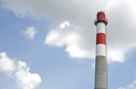 Power plant chimney with blue sky background photo