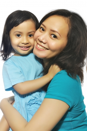 indonesia girl: Portrait of happy mother and daughter isolated over white background