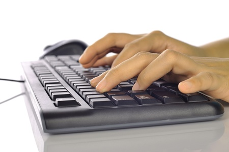 Woman hand typing on black computer keyboard isolated over white background Stock Photo - 17183156