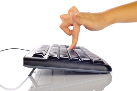 Woman hand typing on black computer keyboard isolated over white background Stock Photo - 17183150