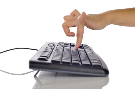 Woman hand typing on black computer keyboard isolated over white background Stock Photo - 17183147