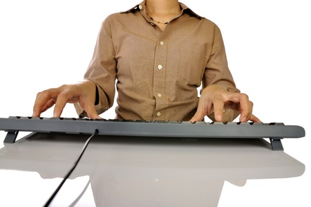 Woman hand typing on black computer keyboard isolated over white background Stock Photo - 17183149