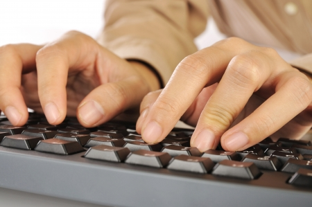 Woman hand typing on black computer keyboard isolated over white background Stock Photo - 17183151