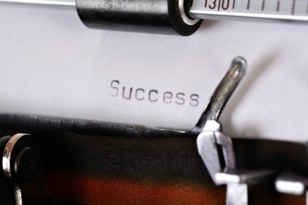 Success typed on the paper with old type writer photo
