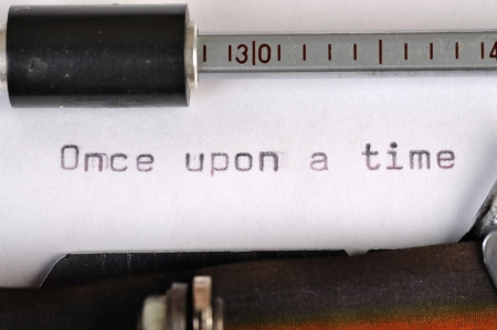 Once Upon A Time typed on the paper with old type writer photo