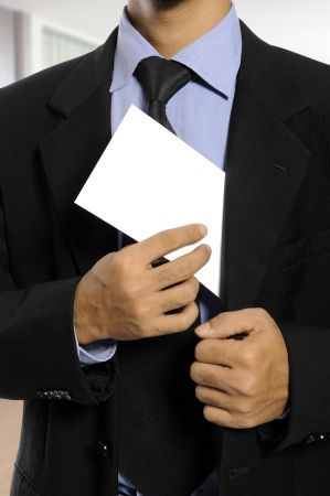 Business man showing blank envelope. You can put your message on the envelope Stock Photo - 18180638