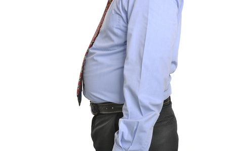 Fat tummy of grown-up man isolated over white background photo