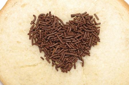 spreaded: Heart shape chocolate sprinkles spreaded in bread Stock Photo