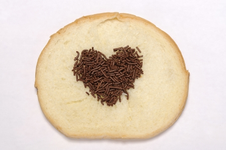 spreaded: Heart shape chocolate sprinkles spreaded in bread Stock Photo