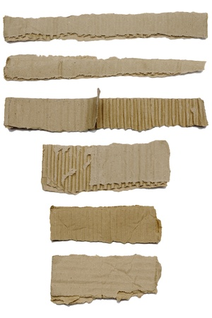 Set of textured cardboard with torn edges isolated over white photo