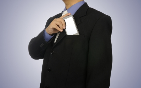 hands in pocket: Man in business suit holding cellphone  You can put your design on the phone