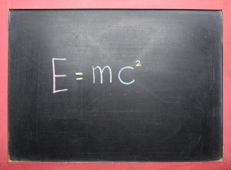 Theory of Relativity handwriting on the black chalkboard