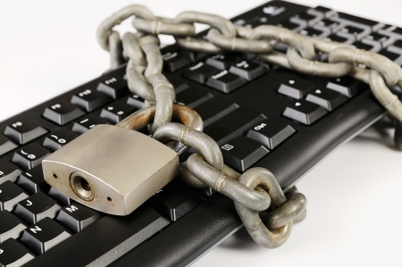 Computer keyboard tied with chain. A computer security concept photo