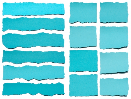 Collection of blue torn pieces of paper on white background  Each one is shot separately photo