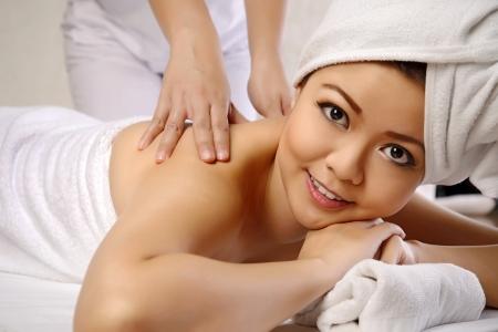back rub: Beautiful asian woman get back rub massage on the spa