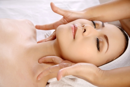salon spa: Beautiful asian woman get facial massage on the spa  Stock Photo