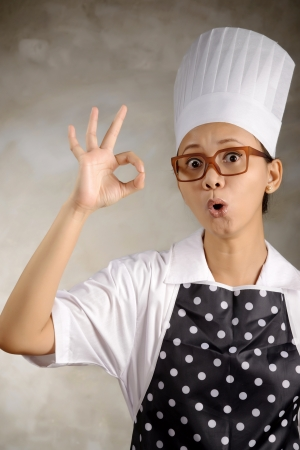 Funny woman chef say its ok  Good food concept Stock Photo - 21144424