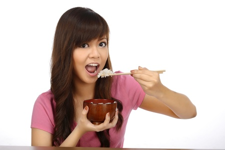 Beautiful asian woman eating japanese food with chopstick over white background photo