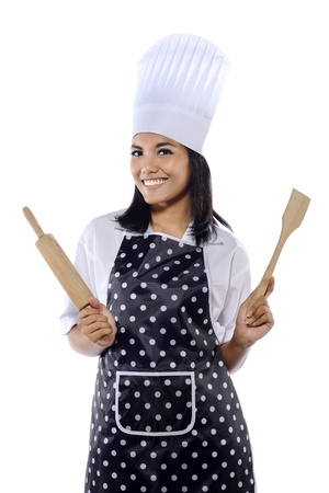 Portrait of beautiful pretty woman chef isolated over white background photo