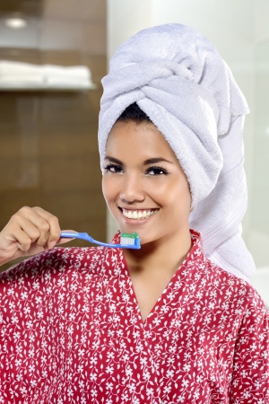 Portrait of pretty asian smiling woman. With bathroom background photo