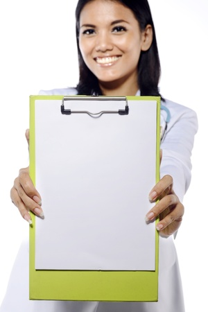 Portrait of young doctor holding clipboard isolated over white background. You can put your message on the board photo