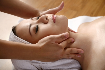 beauty therapist: Beautiful asian woman get facial massage on the spa  Stock Photo