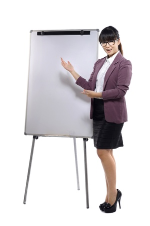 Young attractive business woman standing with a flipchart isolated over white background photo