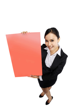 Success woman holding red board isolated over white background. Shoot in high and wide angle view. You can put your design on the board Stock Photo