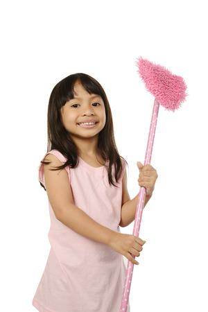 asian gardening: Little girl holding pink cleaning tools isolated over white background Stock Photo