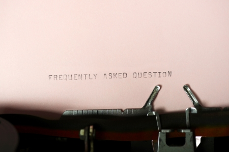 frequently asked question: Frequently Asked Question typing type on purple paper on typewriter