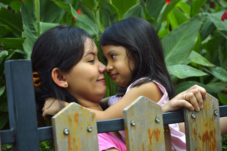 Happy mother and daughter on the garden outdoor photo