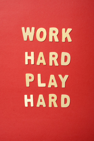 hard wood: Work hard play hard text on red paper backbround