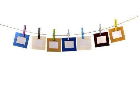 name day: Color frames hanging with name day cloths pin isolated over white