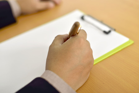 Man writing on blank paper. You can put your design photo