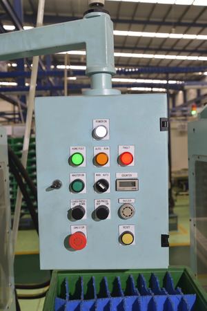 computerised: Control panel with buttons and levers in the factory