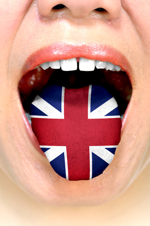 fluent: Conceptual of fluent speaking english. Woman show her tongue with english flag.