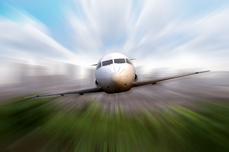 private airplane: Private jet fly with motion blur effect background Stock Photo