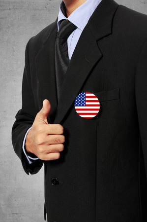 Man wearing 4th of july pin with black suit photo