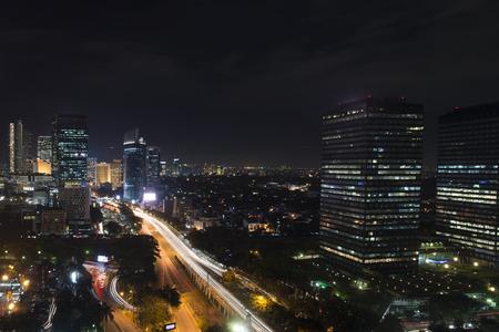 jakarta: Jakarta night cityscape with vehicle light trails Stock Photo