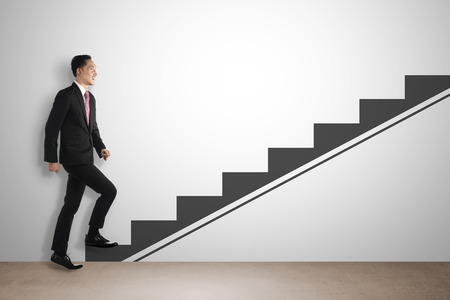 Business man step up imaginary stair. Career development concept Stockfoto