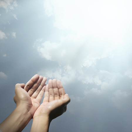 Hand of muslim people praying with abstract background