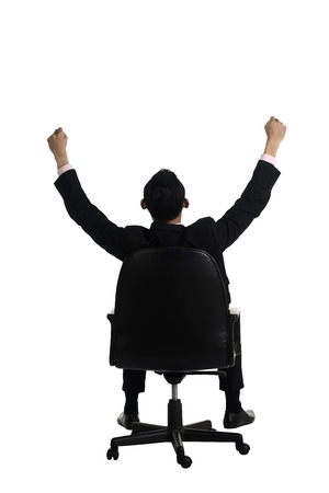 backview: Backview of business man raise hand sitting on the chair isolated over white background Stock Photo