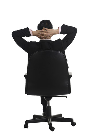 backview: Backview of business man sitting on the chair isolated over white background