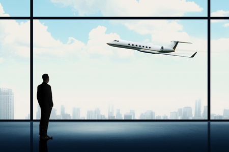 Man looking on the private jet. Business career conceptual photo