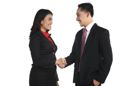 business suit: Business man and woman shake hand isolated over white background