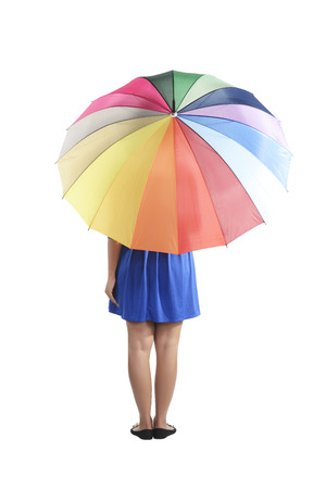 backview: Backview of asian woman holding colorful umbrella isolated over white background