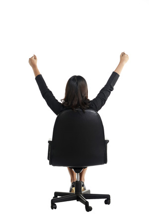 raise hand: Business woman sitting on the chair raise hand isolated over white background Stock Photo