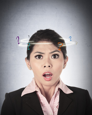 indonesian girl: Asian business woman confused with question mark around her head